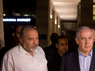 Serious Decisions: Avigdor Lieberman and Benjamin Netanyahu visit the Max Brenner in Tel Aviv's Sarona Market where Palestinian gunmen opened fire on June 8.