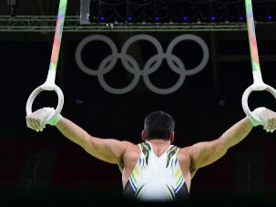 A Brazilian gymnast practices on the rings of the men's Artistic gymnastics during a practice session at the Olympic Arena on August 3, 2016 ahead of the Rio 2016 Olympic Games in Rio de Janeiro.