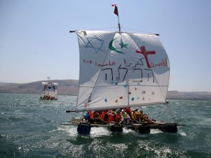 Israeli youths, of Arab and Jewish descent, sail on a handmade raft across the Sea of Galilee in northern Israel.