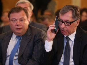 Russian billionaires and businessmen Mikhail Fridman (L) and Petr Aven attend the plenary session of the Congress of Russian Union of Industrialists and Entrepreneurs.