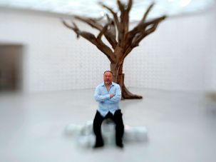 Ai Weiwei pictured in front a 2010 work in his Jerusalem retrospective in June.