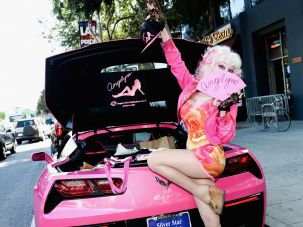 Angelyne Lynne by her trademark pink Corvette at a Los Angeles Pride event in June.