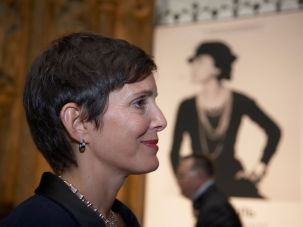 Maureen Chiquet, in front of a photo of Coco Chanel.