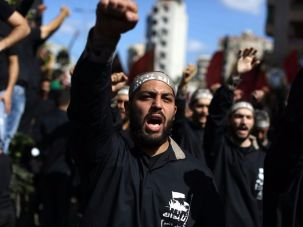 Lebanese Muslim Shiite men affiliated to Hezbollah shout slogans as they mark Ashura in a southern suburb of Beirut on October 1, 2017.