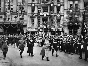An undated picture shows nazi Chancellor Adolf Hitler followed by commander-in-chief Hermann Goering (2nd L) and head of the SS Heinrich Himmler (3rd L) marching in Berlin next to the hotel Excelsior which was Hitler's base in the city in the early 1930s.