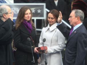 Emma and Georgina Bloomberg with their father, Michael Bloomberg, as he swears in for his third term as New York City mayor.