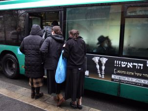 Orthodox young women boarding bus in Jerusalem.