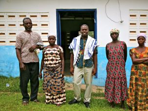 Spiritual leader Alex Armah (center) with community members at shacharit (morning) service at Tifereth Israel Synagogue, House of Israel Jewish Community. New Adiembra, Ghana. February 2014.