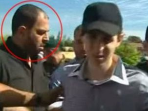 Hamas Leader: Raed Al-Attar, left, seen in image of Gilad Shalit's release from Hamas abduction, October 2013.