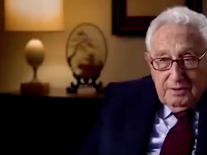 """Henry Kissinger, who says in the video that he gives Hillary Clinton """"high marks"""" for public service."""