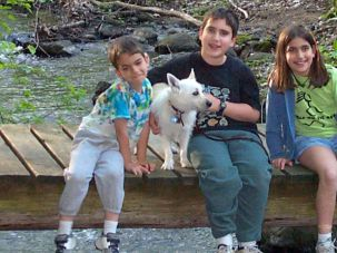 Rocki with his human siblings, circa 2001