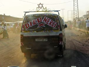 Philosemitic Display: A microbus with a Jewish star on it drives one of Goma's main streets.