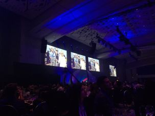 Pictures of Sheldon Adelson projected on a screen at the Israeli-American Council's convention in Washington, D.C.