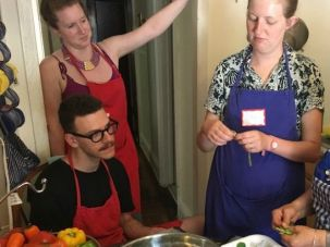 Jeanette Chawki, far right, teaches League of Kitchens workshop participants how to cook Lebanese food.