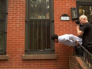 Cinema Verité: A camera man films Manny Waks as he shouts through a window into the home of a man he accuses of sexually assaulting him more than 25 years ago.