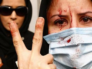 Revolution in Tehran?: An injured Iranian opposition activist during anti-government protests in December of 2009.