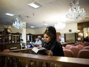 A young Jewish Iranian woman prays at a synagogue in Tehran.