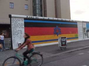 The flags of Israel and Germany merged on a section of the Berlin Wall.