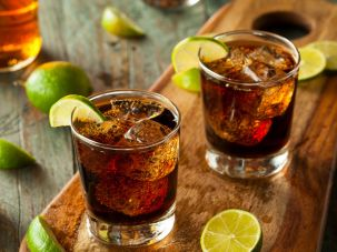 a rum and Cola Cuba Libre cocktail.