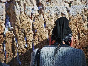 Jewish woman prays at the Western Wall.