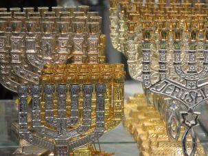 Menorahs for sale in a Judaica shop.