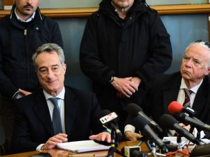 Italian prosecutor Maurizio Romanelli (L) speaks during a press conference on April 28, 2016 in Milan as four people accused of terrorism were arrested near Milan.