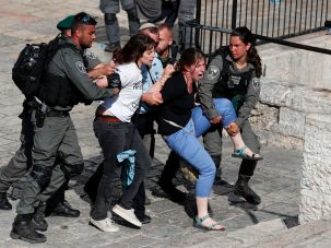 Protesters evacuated by Israeli police during a protest outside Jerusalem's Damascus Gate, May 24, 2017