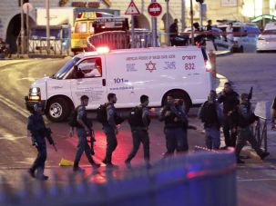 Israeli security forces and an ambulance are seen at the scene of an attack outside Damascus Gate in Jerusalem's Old City on June 16, 2017. An Israeli policewoman was killed in the attack; security forces shot three suspected Palestinian assailants.