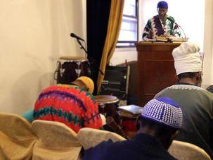 Davening, Israelite-style: Kahtriel Ben Yisrael leads temple members in prayer.
