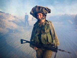 A female soldier from the mixed-sex Caracal Battalion in action during training near the Israeli-Egyptian border.