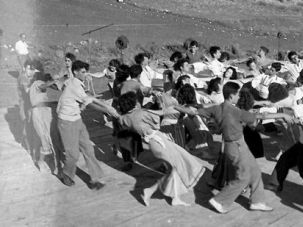 Community: Members of the Mishmarot kibbutz in Northern Israel perform the ?Hora.?