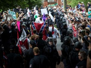 Members of the Ku Klux Klan are escorted out of a planned rally on July 8, 2017 in Charlottesville, Virginia.