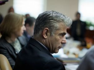 Obstruction: Finance Minister Yair Lapid might pull out of the governing coalition.