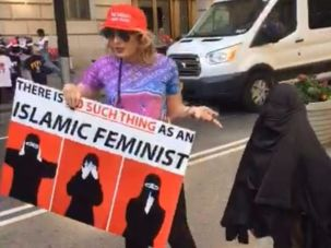 """Laura Loomer put a burqa on the """"Fearless Girl"""" statue in New York's Financial District during the March Against Sharia on June 10th."""