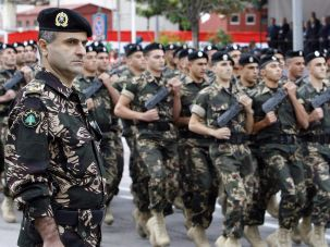 Lebanese soldiers parade to mark Independence Day in downtown Beirut.