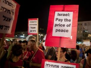 Resilient: Israelis take part in a demonstration calling for negotiations between Israel and the Palestinians on August 16 in Tel Aviv.