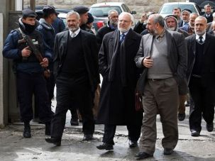 Lockout: Aziz Dweik, center wearing scarf, and other Hamas lawmakers leave the Palestinian Legislative Council?s building in Ramallah on March 1 after being denied entry by security forces loyal to the Palestinian Authority.