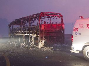 First Responder: A U.S.-funded MDA ambulance rushed to the scene last December after a bus carrying prison guards was trapped and incinerated in a huge forest fire in northern Israel.