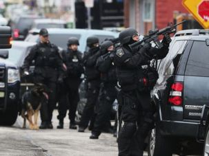 Lockdown City: A manhunt continued throughout the day on Friday in and around Boston.