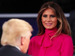 Melania Trump smiles near her young-at-heart spouse.
