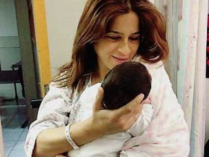 Merav Ben Ari holds her baby daughter Ariel.