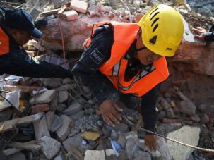 A member of the Federal Police's rescue team searches for survivors in Juchitan de Zaragoza, Mexico, on September 9, 2017 after a powerful earthquake struck Mexico's Pacific coast late on September 7.