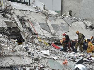 Israeli rescuers search for survivors in a flattened building in Mexico City on September 21, 2017 two days after a strong quake hit central Mexico.