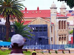 First Shul Standing: Built in 1905, the Doornfontein Synagogue is the oldest synagogue building in Johannesburg. It is informally known as Lions Shul for the statues at its entrance. The big cats are here obscured by the blue fence.