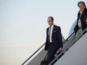 White House aides Stephen Miller (left) and Steve Bannon descend from Air Force One.