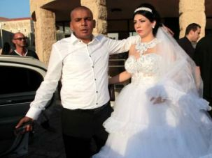 Mahmoud Mansour and Morel Malka on their wedding day, August 17, 2014