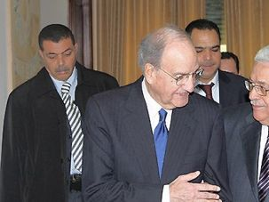 Negotiator: George Mitchell (left) speaks with Palestinian Authority President Mahmoud Abbas. Mitchell is engaged in a turf battle with fellow American negotiator Dennis Ross.