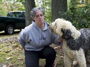 Sanctuary: Rabbi Robin Nafshi with Monty, a resident at the Seer Farms animal shelter.