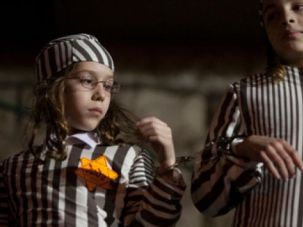 Haredi children wearing concentration-camp uniforms and yellow Stars of David during a 2012 demonstration.