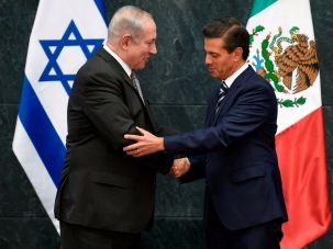 Israeli Prime Minister Benjamin Netanyahu shakes hands with Mexican President Enrique Pena Nieto in Mexico City, September 14, 2017.